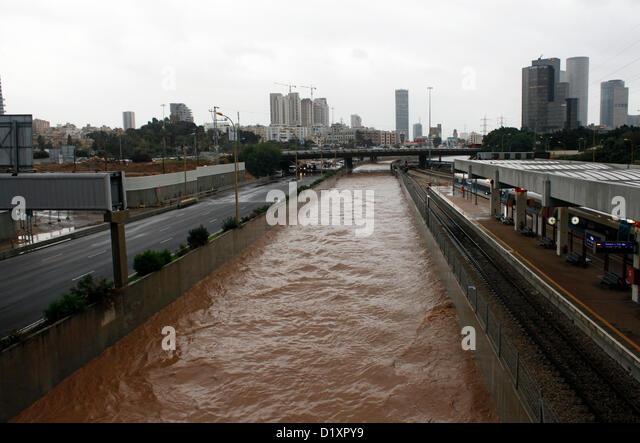 River overflows onto Tel Aviv's main artery, Ayalon Highway, due to heavy rainfall in Tel Aviv Israel - Stock Image
