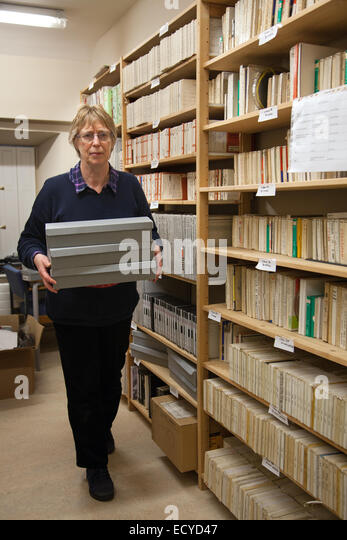 Old recording Sound Archives on tape and disk,  stored in Clitheroe Castle, Lancashire, UK. Ms Carole Enwistle facing - Stock Image