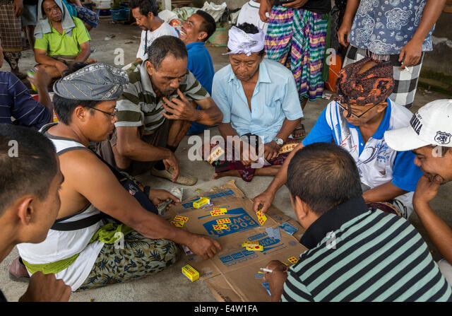 Bali, Indonesia. Gambling with Dominoes.  Dlod Blungbang Village. - Stock Image