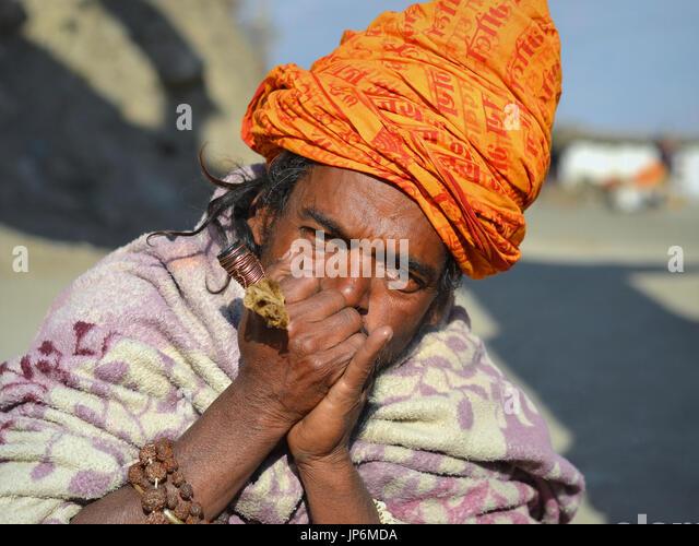 Nepalese Sadhu with Chillum Pipe, Muktinath. - Stock Image