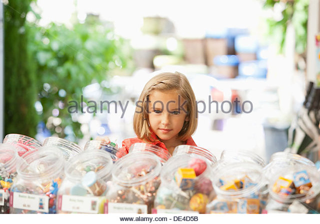 Girl shopping in toy store - Stock Image