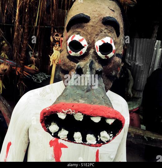 A Salvadoran boy, wearing a home made mask, takes part in an annual festivity of Día de la Calabiuza in Tonacatepeque, - Stock-Bilder