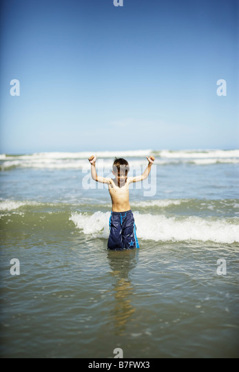 Himatangi beach New Zealand six year old boy - Stock Image