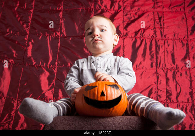 Portrait of a little boy dress up for halloween party. He has a serious suspecting expression - Stock Image