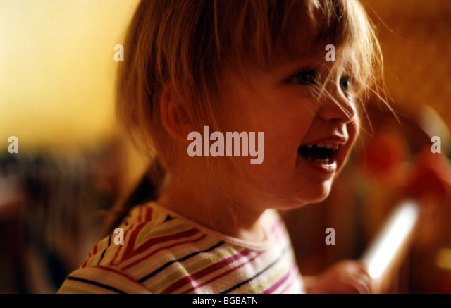 Photograph of happy young girl daughter smiling laughing giggle - Stock-Bilder