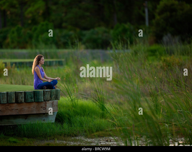 Meditation in peaceful setting - Stock Image
