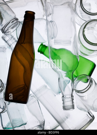 Backlit collection of glass bottles and jars - Stock Image