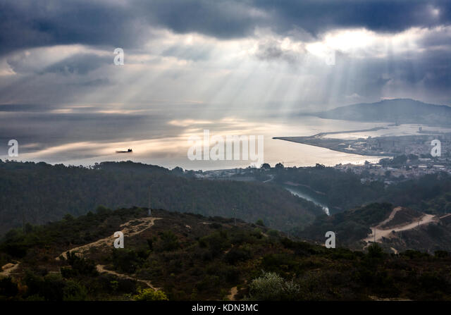 View of Ceuta from the Viewpoint of Isabel II.  Spanish town in africa under the sun rays on a cloudy foggy day - Stock Image