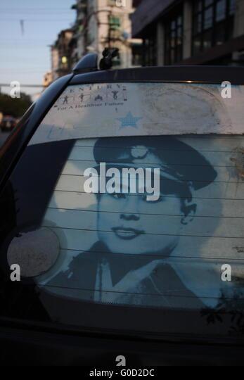 A photograph of Aung San, founder of modern Burma and father of Aung San Suu Kyi, in a car window in Yangon, Burma. - Stock-Bilder