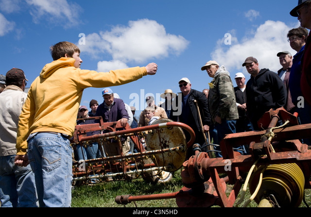 Young teen handles auction of farm equipment in Mohawk valley of central New York State - Stock Image
