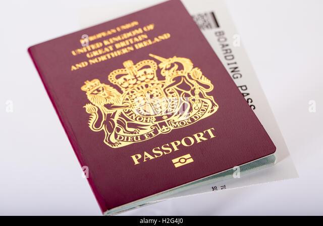 A British UK Passport and plane boarding card - Stock Image