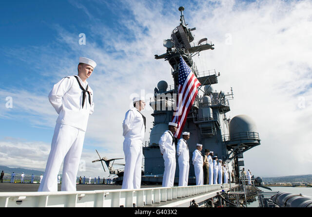 Sailors man the rails as aboard USS Peleliu. - Stock Image