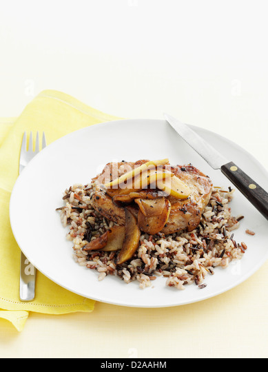 Plate of pork with wild rice - Stock Image