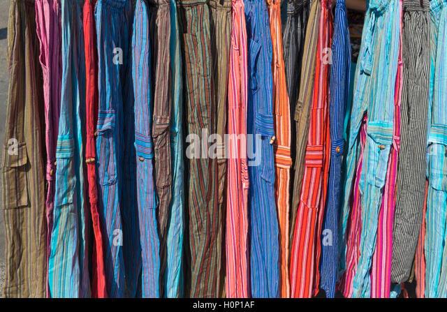 Colourful clothes Feira da Ladra Thieves' Market Campo de Santa Clara Lisbon Portugal - Stock Image