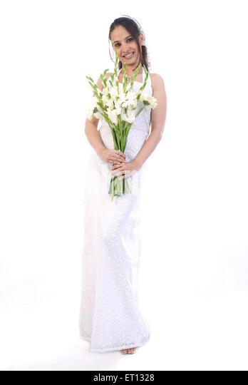 Christen bride in white gown and veil holding flowers MR#733C - Stock-Bilder