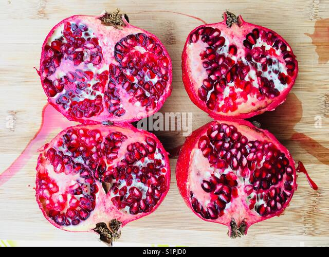 Two Pomegranate cut in half - Stock Image
