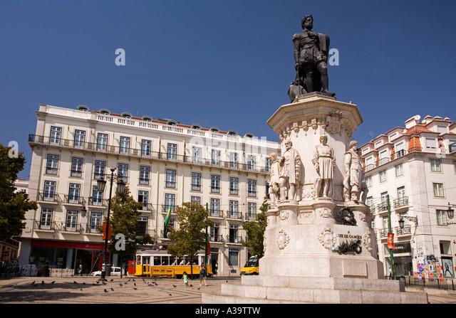 Portugal Lisbon statue by Luiz de Camoes yellow tram electrico Barrio Alto - Stock Image