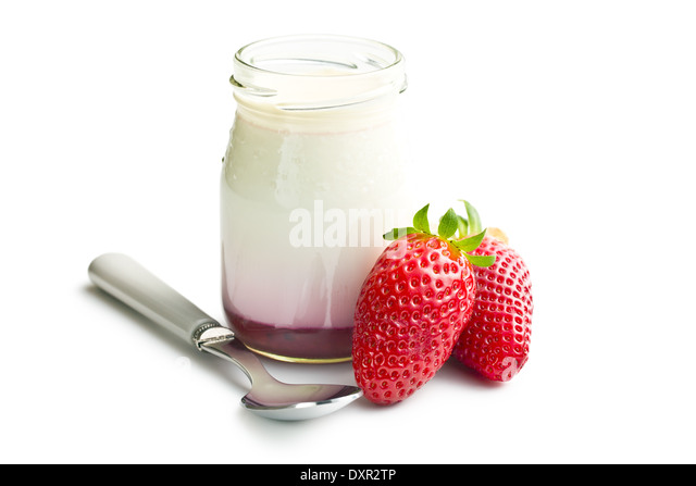 yogurt in jar with strawberries on white background - Stock Image