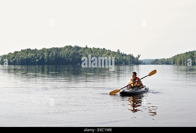 Father and son kayaking on lake, Ontario, Canada - Stock Image