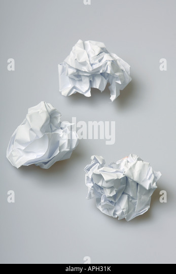 Crumpled paper wads on the floor concept for creative block - Stock Image