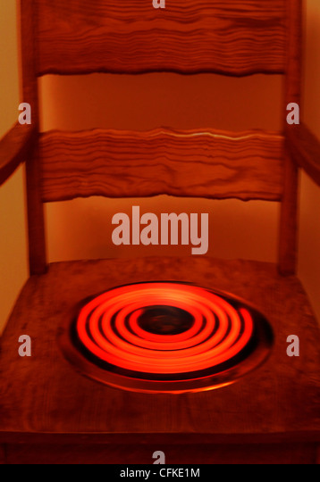 FV5293, Vast Photography; Wooden Chair with Red Hot Element - Stock Image