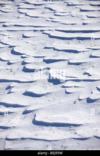 Winter background texture wind blown snow closeup - Stock Image