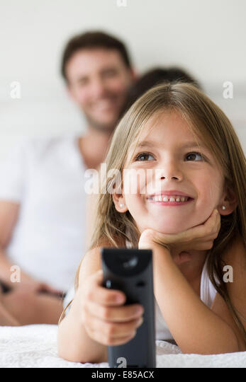 Little girl holding remote control - Stock Image