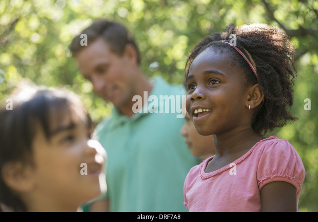 Utah USA children and adults in the shade of woodland - Stock Image