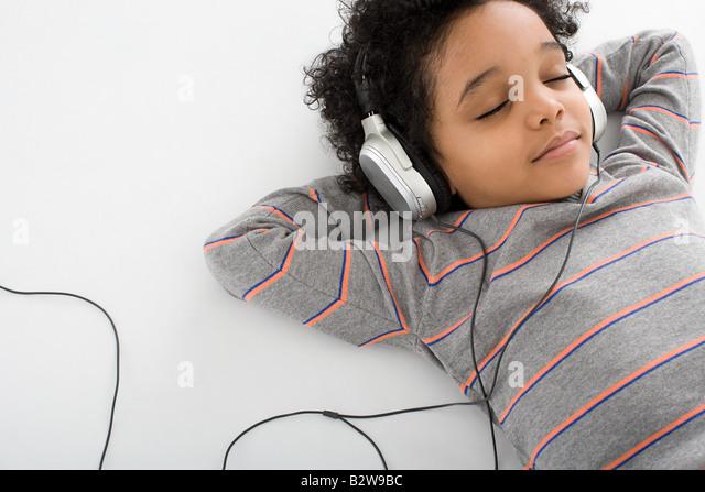 Boy listening to music - Stock-Bilder