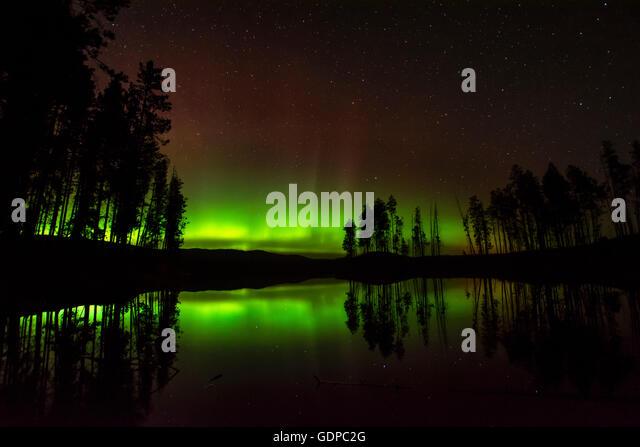 Aurora borealis over Ellis reservoir, Okanagan Valley, Penticton, British Columbia, Canada - Stock Image