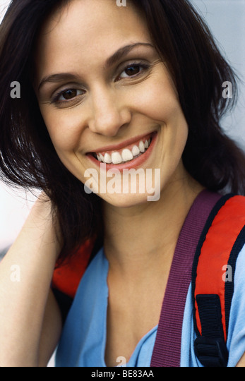 Woman smiling, portrait - Stock Image