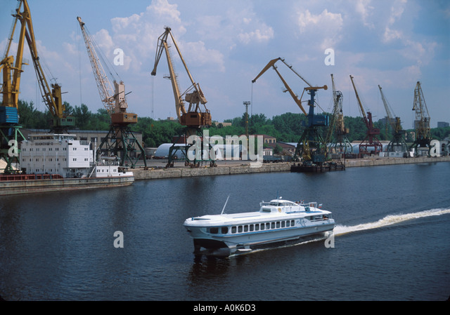 Russia former Soviet Union Moscow Canal hydrofoil water taxi cargo lifting cranes canal links to Volga River - Stock Image