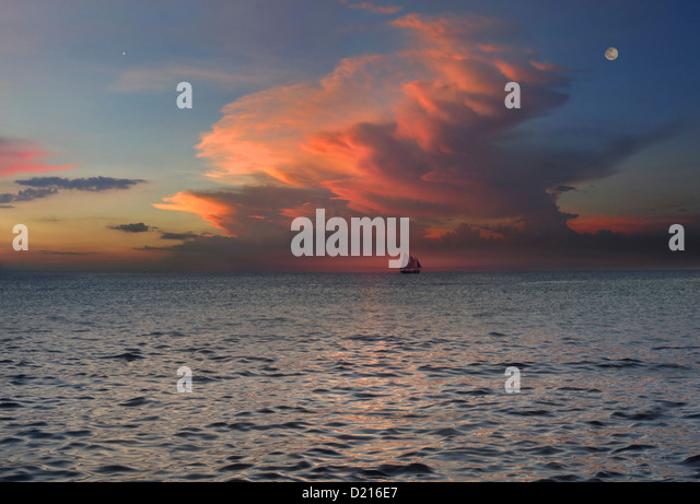 View of sloop on the horizon at sunset, Boracay, Philippines, Asia - Stock Image