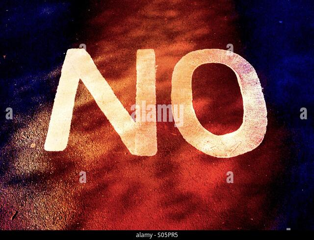 Close up of the word 'NO' on pavement - Stock Image