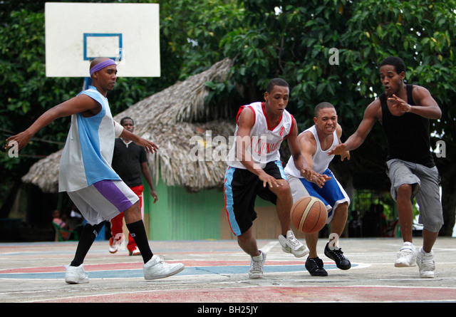 Neighborhood basketball game, Bahoruco, Dominican Republic - Stock Image