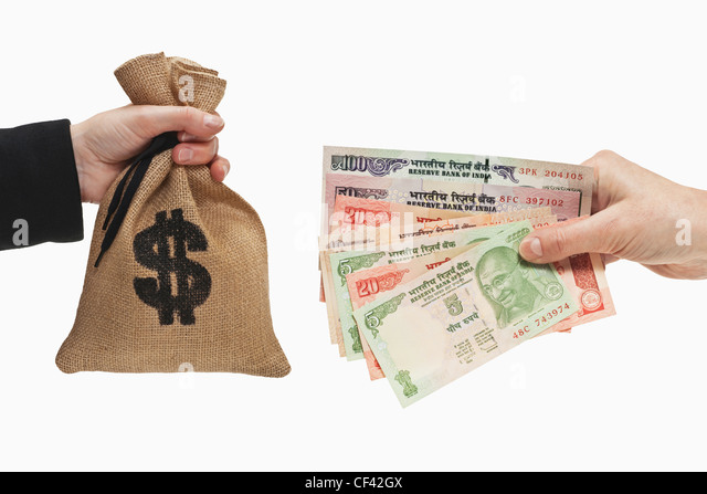 Many diverse Indian rupee bills are held in the hand. At the other side is a money bag with U.S. Dollar currency - Stock-Bilder