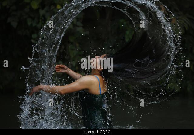 Kathmandu, Nepal. 12th January, 2017. A Nepalese Hindu devotee submerges taking a holy dip at Saalinadi River on - Stock Image