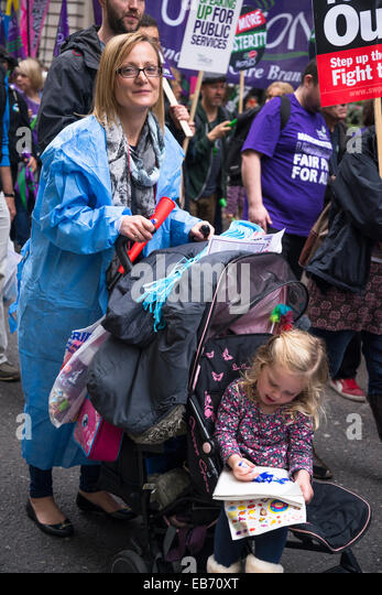 Britain Needs a Pay Rise march, London, Mother with a child in pushchair, 18 October 2014, UK - Stock Image