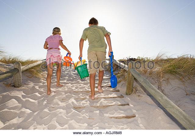 Family leaving the beach - Stock-Bilder