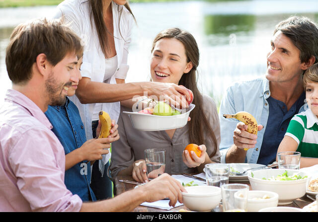 Family enjoying healthy picnic - Stock Image