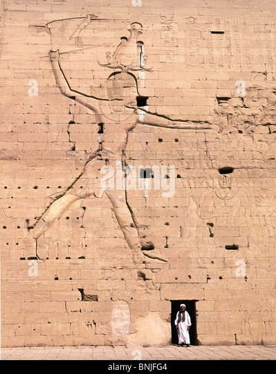 Egypt March 2007 Edfu city Horus Temple ancient historic culture man wall - Stock Image