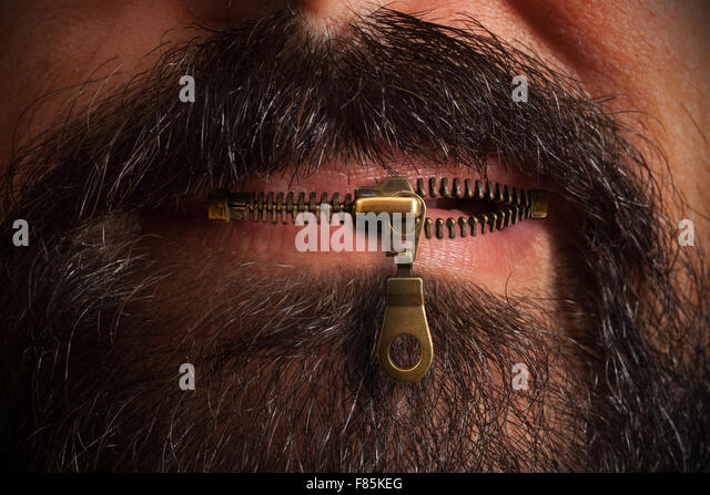 Beard man with zipped mouth - Stock Image