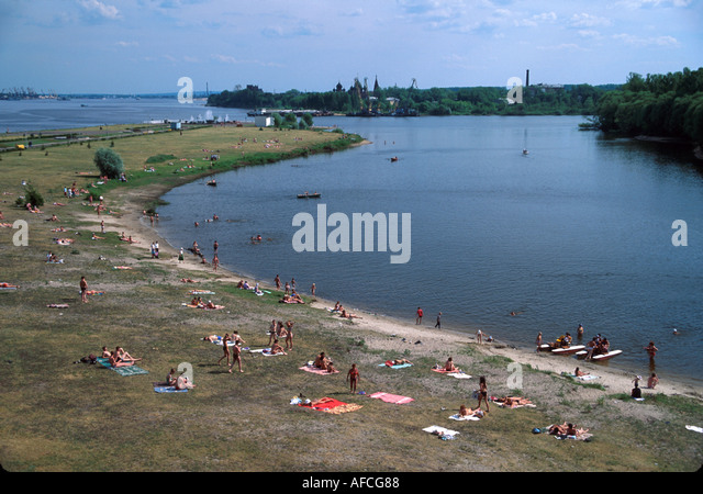 Russia former Soviet Union Yaroslavl city park residents swimming junction of Kotorosl & Volga Rivers - Stock Image
