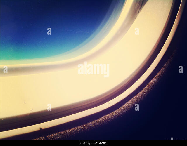 Part of window in airplane cabin - Stock Image