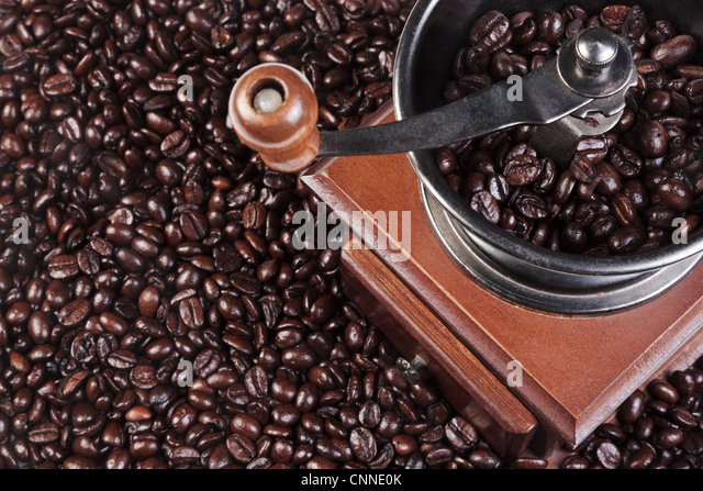 Photo of a coffee grinder with fresh roasted arabica and robusta beans - Stock Image
