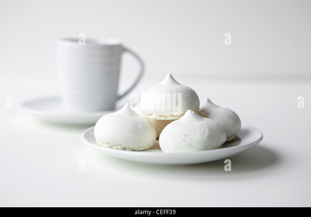 Mini meringues on plate - Stock Image
