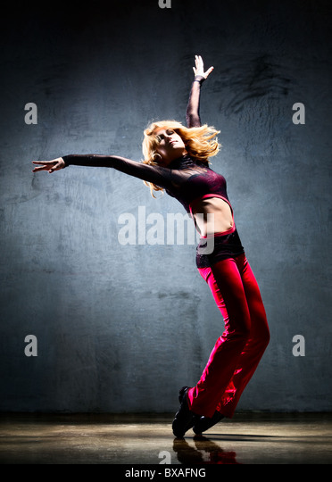 Young woman dancer. On wall background. - Stock Image