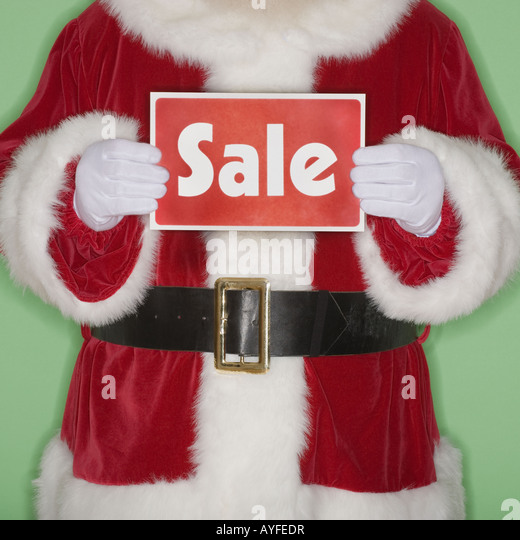 Santa Claus holding Sale sign - Stock Image