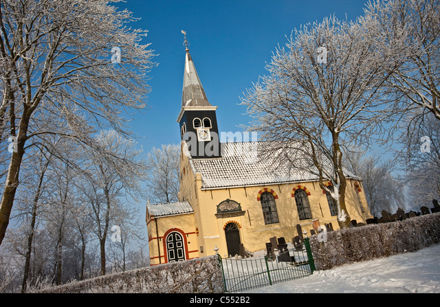 The Netherlands, Ferwoude, Church in frost and snow. - Stock Image