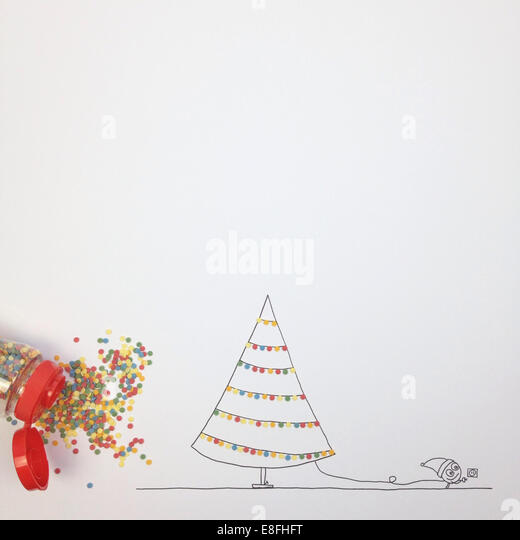 Conceptual fantasy character decorating Christmas tree with fairy lights - Stock Image
